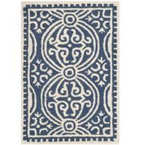 Tmavomodrý vlnený koberec Marina Navy, 91×152 cm
