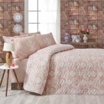 Ružový pléd cez posteľ na dvojlôžko s oblie...